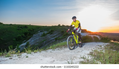 Cyclist Riding the Bike on the Beautiful Mountain Trail.