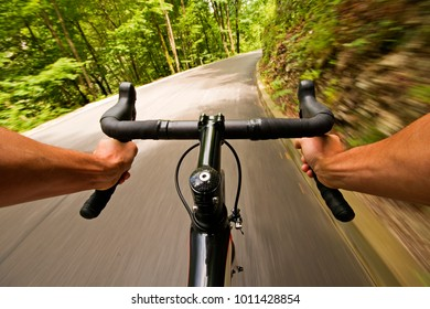 Cyclist riding a bike on the road in nature