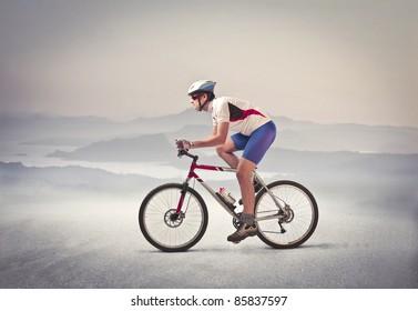Cyclist riding a mountain bike in a desert