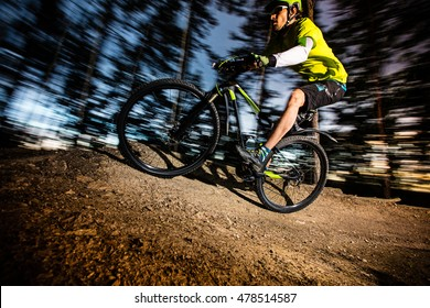 Cyclist riding a mountain bike downhill style.