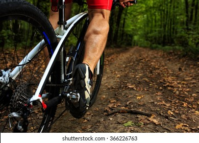 cyclist riding mountain bike on rocky trail