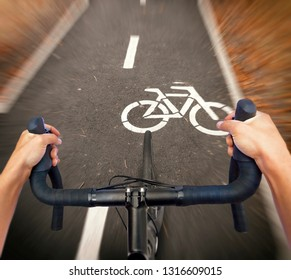 A cyclist is riding a new road bike through the cycle path