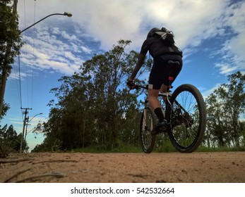 Cyclist riding on the rural road
