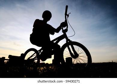 Cyclist silhouette on BMX bike