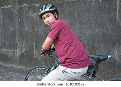 Cyclist sitting and leaning in the handle bar of a bicycle.