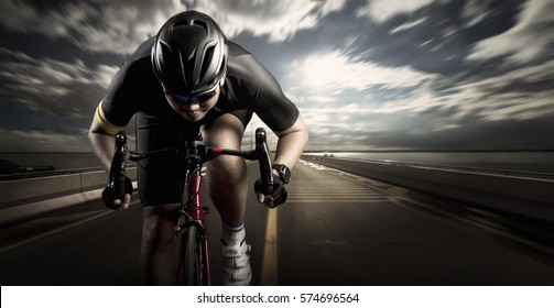 Cyclist. Sport man cycling on road.