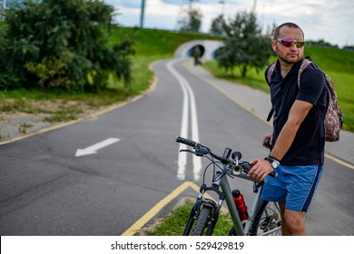 cyclist stands on the bike path