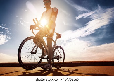 Cyclist stopped in the sun. Race winner