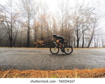 cyclist training in winter with fog. Motion Blur effect