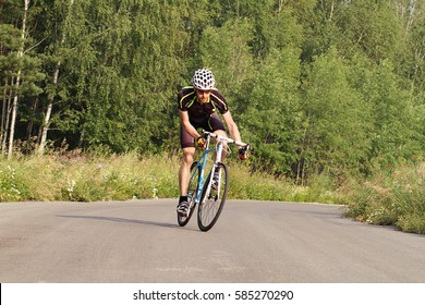 cyclist trains young male in a sports bike.