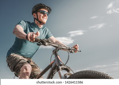 Cyclist. Young man on the mountain bike.