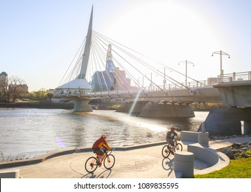 Cyclists along Red River in a sunny day, Winnipeg - Canada