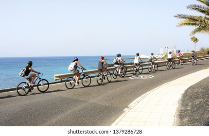 Cyclists in Costa Teguise, Lanzarote, Canary Islands, Spain, Europe