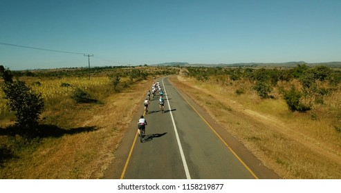 Cyclists long termac stretched road open in Malawi Africa