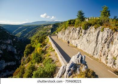 Cyclists on the Gorges de la Nesque road in Vaucluse Mountains region