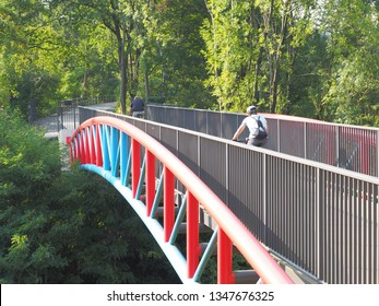 Cyclists on so-called Nordbahntrasse in Wuppertal /North Rhine Westphalia /Germany in sumer 2018. The popular Nordbahntrasse is a former railroad route right through the town