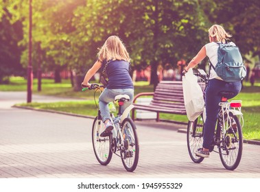 Cyclists ride on the bike path in the city Park