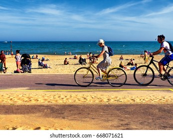 Cyclists at sandy beach, Bournemouth, Dorset June 2017; editorial