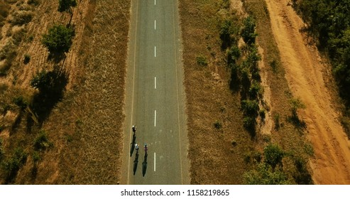 Cyclists tarmac shadows birds eye view in Malawi Africa