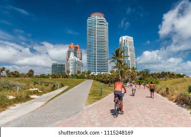 Cyclists and tourists in South Pointe Park on a sunny day, Miami, Florida, USA.