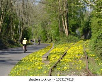 Cyclists are traveling on the Nordbahntrasse a former railway line in Wuppertal NRW Germany in springtime 2019.