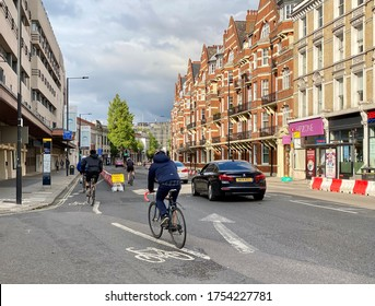 Cyclists using temporary cycle lanes in Hammersmith London UK June 2020