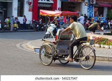 "Cyclo in Hanoi, Vietnam on 23, dec 2016. Visit Hanoi by cyclo to dive in the soul of Hanoi. This ""authentic"" way allow visitors discover the city center in intense emotions. this is Hanoi culture"