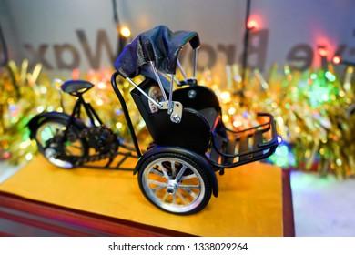 Cyclo model when you visit Hanoi, Vietnam