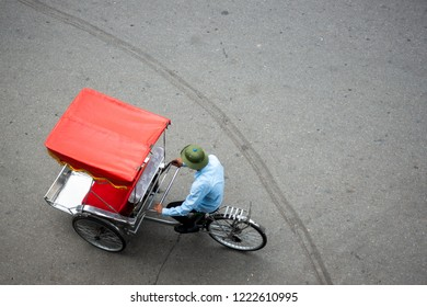 Cyclo or pedicab driver on Hanoi street