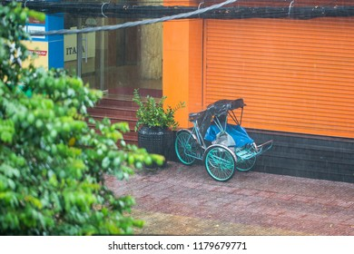 A cyclo is waiting for the guests in a raining day at Ho Chi Minh City, Vietnam