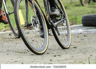 Cyclocross bicycle rider cornering in turn on asphalt