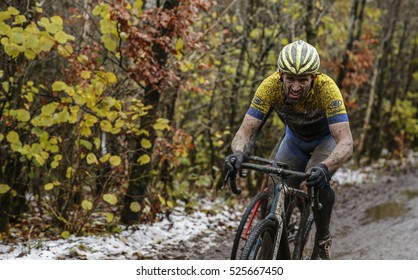 Cyclo-Cross Race, Parc Bryn Back, Tredegar. Wales, U.K.  Oct-20-2016Cyclist racing in the snow and mud