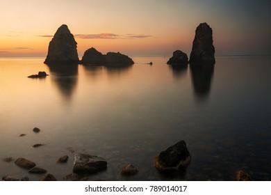 Cyclopean Isles in Aci Trezza (Sicily - Italy) at sunrise.
