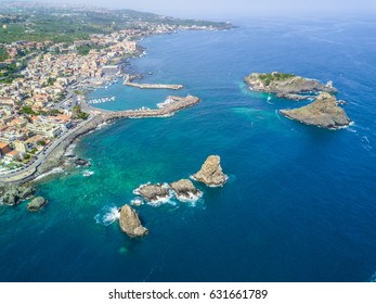 Cyclops islands, Acitrezza, Sicily. Basalt rocks on the sea view from top - Catania, Sicily - Italy