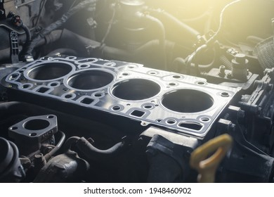 Cylinder head gasket replacement. Repair of a turbocharged diesel old engine in a car workshop. Blur effect.