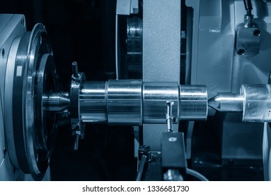 The cylindrical grinding machine.The automotive part manufacturing process.
