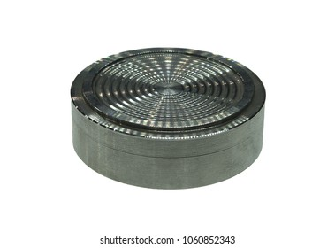 Cylindrical metal part with concentric notches, image with shallow depth of field