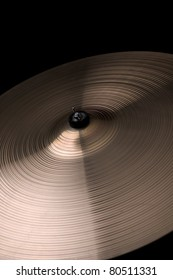 A cymbal on a black background