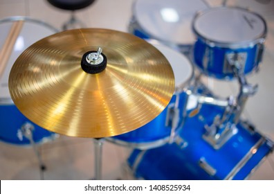 Cymbal as part of a drum set on display in music instruments shop