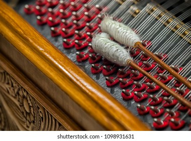 Cymbal,Cimbalom or Cembalon selective focus.Close up of  strings and wound beaters.The cimbalom is a concert hammered dulcimer,a type of chordophone. Cymbal is a very special string music instrument.