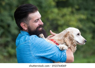 Cynologist concept. Dog park. Man with labrador outdoors. Man with puppy