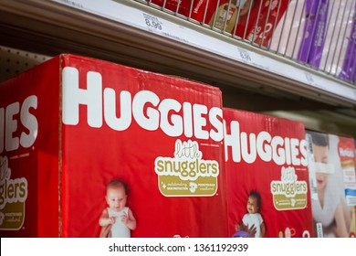 Cypress, California/United States - 03/19/19: Several boxes of Huggies brand diapers, on a shelf at a grocery store