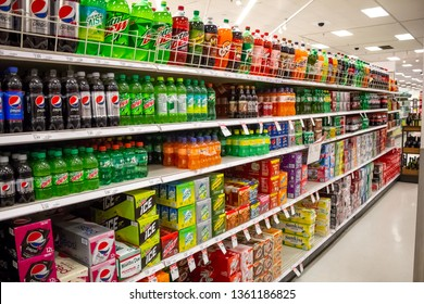 Cypress, California/United States - 03/19/19: The soda aisle of a grocery store, featuring several brands and colors of carbonated beverages