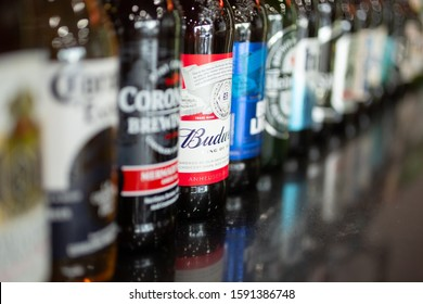 Cypress, California/United States - 11/30/2019: A row of several popular beer brands on the counter of a restaurant, featuring Budweiser