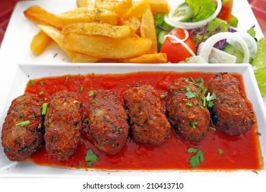 Cypriot food-keftedes (meatballs in sauce)