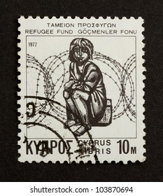 CYPRUS - 1972: Stamp printed in Cyprus shows a sitting refugee (refugee fund), 1970