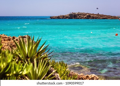 Cyprus, Ayianapa, Nissi beach. View of turquoise water Nissi beach coastline. Beautiful landscape near of Nissi beach and Cavo Greco Mediterranean Sea. Amazing blue green sea and sunny day.