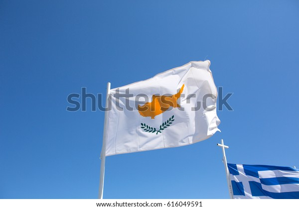 Cyprus, the developing Cyprus and Grece flag, spring, a bright day, sunrays on March 24, 2017