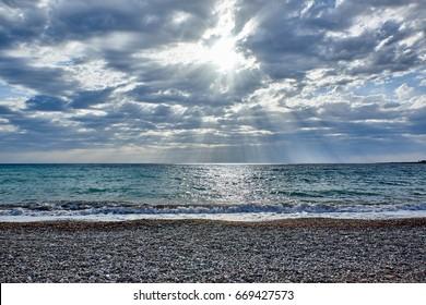 Cyprus. The Kissonerga. Evening. Pebble beach. The solar cone - Shutterstock ID 669427573