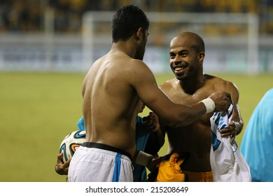 CYPRUS, LARNAKA-JUL 30:Ael Limassol player Dede  and  Zenit player Hulk change t shirt after their Champions League third qualifying round second leg in Larnaca, Cyprus, Tuesday, July 30, 2014